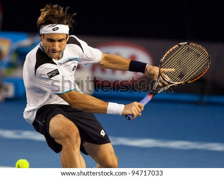 MELBOURNE - JANUARY 25: David Ferrer of Spain in his quarter final loss to  Novak Djokovic of Serbia at the 2012 Australian Open on January 25, 2012 in Melbourne, Australia. - stock photo