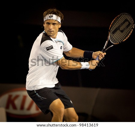 MELBOURNE - JANUARY 25: David Ferrer of Spain in his quarter final loss to  Novak Djokovic of Serbia at the 2012 Australian Open on January 11, 2012 in Melbourne, Australia. - stock photo