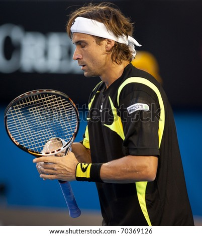 MELBOURNE - JANUARY 26: David Ferrer of Spain in his quarter final lwin over Rafael Nadal of Spain  in the 2011 Australian Open on January 26, 2011 in Melbourne, Australia