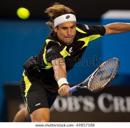 MELBOURNE - JANUARY 26: David Ferrer of Spain in his quarter final win over Rafael Nadal of Spain in the 2011 Australian Open on January 26, 2011 in Melbourne, Australia - stock photo