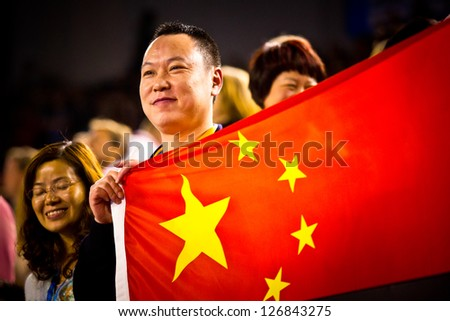 MELBOURNE - JANUARY 26: Fans with Chinese flag at the Australian Open Womens final between Li Na of China andVictoria Azarenka of Belarus on January26, 2013 in Melbourne, Australia. - stock photo