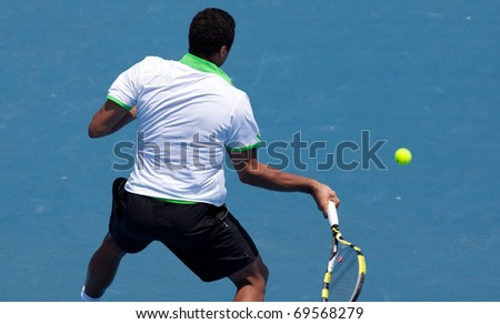 MELBOURNE - JANUARY 22:  Jo-Wilfried Tsonga of France in his third round loss to Alexandr Dolgopolov  of Ukraine in the 2011 Australian Open on January 22, 2011 in Melbourne, Australia.