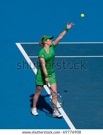 MELBOURNE - JANUARY 22: Kim Clijsters of Belgium in her third round win over Alize Cornet of France in the 2011 Australian Open - January 22, 2011 in Melbourne