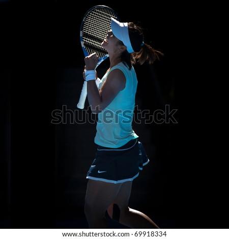 MELBOURNE - JANUARY 27: Li Na of China celebrates her semi final win over Caroline  Wozniacki of Denmark in the 2011 Australian Open on January 27, 2011 in Melbourne, Australia - stock photo