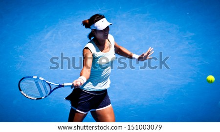 MELBOURNE - JANUARY 23: Li Na of China in her in her fourth round win over Victoria Azarenka of Belarus in the 2011 Australian Open on January 23, 2011 in Melbourne, Australia - stock photo