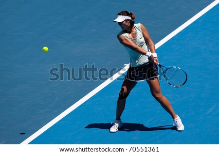 MELBOURNE - JANUARY 23: Li Na of China in her in her fourth round win over Victoria Azarenka of Belarus in the 2011 Australian Open on January 23, 2011 in Melbourne, Australia