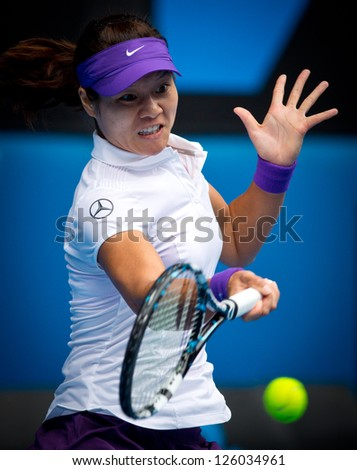 MELBOURNE - JANUARY 22: Li Na of China in her quarter final win over Agnieszka Radwanska of Poland at the 2013 Australian Open on January 22, 2013 in Melbourne, Australia. - stock photo