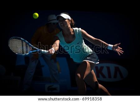 MELBOURNE - JANUARY 27: Li Na of China  in her semi final win over Caroline  Wozniacki of Denmark in the 2011 Australian Open on January 27, 2011 in Melbourne, Australia - stock photo