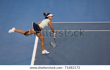 MELBOURNE - JANUARY 29: Li Na of China in the final of the 2011 Australian Open on January 29, 2011 in Melbourne, Australia - stock photo