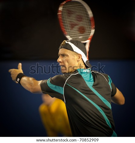 MELBOURNE - JANUARY 18: Lleyton Hewitt of Australia in his first round loss to David Nalbandian of Argentina in the 2011 Australian Open on January 18, 2011 in Melbourne, Australia. - stock photo