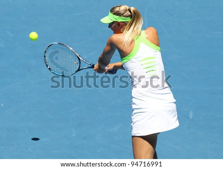 MELBOURNE - JANUARY 17: Maria Sharapova of Russia in her first round win over Gisela Dulko of Argentina the 2012 Australian Open on January 17, 2012 in Melbourne, Australia.