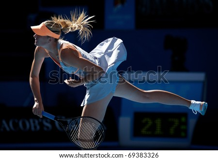 MELBOURNE - JANUARY 19: Maria Sharapova of Russia in her second round win over Virginie Razzano of France in the 2011 Australian Open - January 19, 2011 in Melbourne - stock photo