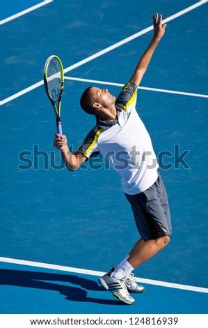 MELBOURNE - JANUARY 14: Mikhail Youzhny of Russia in his first round win over Matthew Ebden of Australia at the 2013 Australian Open on January 14, 2013 in Melbourne, Australia.