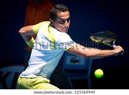 MELBOURNE - JANUARY 22: Nicolas Almagro of Spain in his marathon quarter final loss to David Ferrer  at the 2013 Australian Open on January 22, 2013 in Melbourne, Australia. - stock photo
