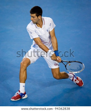 MELBOURNE - JANUARY 29: Novak Djokovic of Serbia in his championship win over Rafael Nadal of Spain at the 2012 Australian Open on January 29, 2012 in Melbourne, Australia. - stock photo
