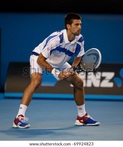 MELBOURNE - JANUARY 25: Novak Djokovic of Serbia in his quarter final match against  Tomas Berdych on his way to the 2011 Australian Open final.  January 25, 2011 in Melbourne, Australia. - stock photo