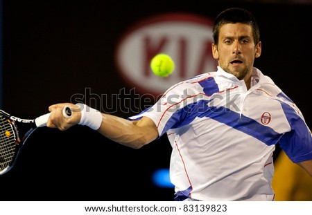 MELBOURNE - JANUARY 25: Novak Djokovic of Serbia in his quarter final match against  Tomas Berdych of the Czech Republic on his way to the 2011 Australian Open final on January 25, 2011 in Melbourne, Australia. - stock photo