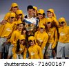 MELBOURNE - JANUARY 30: Novak Djokovic of Serbia poses with ballboys after winning the 2011 Australian Open final on January 30, 2011 in Melbourne, Australia. - stock photo