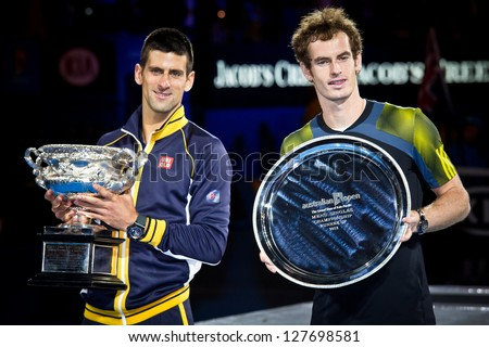 MELBOURNE - JANUARY 27: Novak Djolovic (L) of Serbia with the trophy for winning the 2013 Australian Open against Andy Murry of Scotland (R) on January27, 2013 in Melbourne, Australia. - stock photo