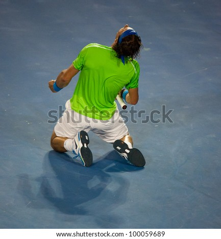 MELBOURNE - JANUARY 29: Rafael Nadal of Spain in his loss in the final to Novak Djokovic of Serbia at the 2012 Australian Open on January 29, 2012 in Melbourne, Australia. - stock photo