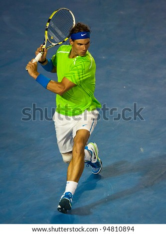 MELBOURNE - JANUARY 29: Rafael Nadal of Spain in his loss to Novak Djokovic of Serbia in the final of  the 2012 Australian Open on January 29, 2012 in Melbourne, Australia. - stock photo