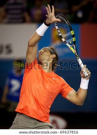 MELBOURNE - JANUARY 22: Rafael Nadal of Spain in his third round win over Bernard Tomic of Australia in the 2011 Australian Open on January 22, 2011 in Melbourne, Australia. - stock photo