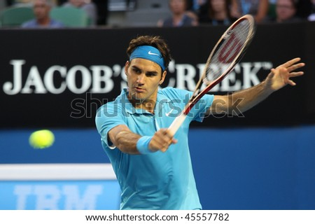 MELBOURNE - JANUARY 27: Roger Federer hits a backhand in his win over Nikolay Davydenko during a quarter final match in the 2010 Australian Open on January 27, 2010 in Melbourne - stock photo