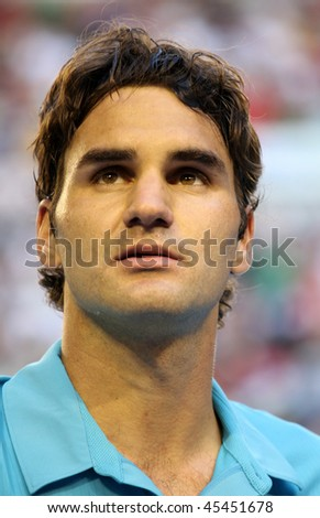 MELBOURNE - JANUARY 27: Roger Federer looks on after his win over Nikolay Davydenko during a quarter final match in the 2010 Australian Open on January 27, 2010 in Melbourne - stock photo