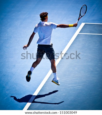 MELBOURNE - JANUARY 25: Roger Federer of Switzerland in his quarter final win over Stanislas Wawrinka of Switzerland in the 2011 Australian Open on January 25, 2011 in Melbourne, Australia - stock photo