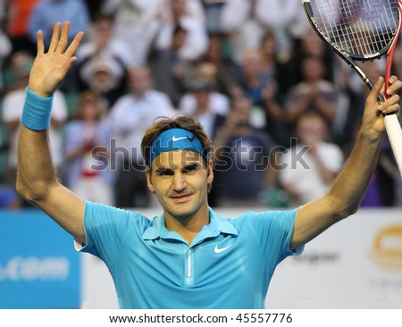 MELBOURNE - JANUARY 27: Roger Federer waves to the crowd after his win over Nikolay Davydenko during a quarter final match in the 2010 Australian Open on January 27, 2010 in Melbourne - stock photo
