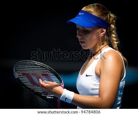 MELBOURNE - JANUARY 21: Sabine Lisicki of Germany in her third round win over Svetlana Kuznetsova of Russia at the 2012 Australian Open on January 21, 2012 in Melbourne, Australia. - stock photo