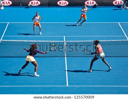 MELBOURNE - JANUARY 22: Serena (L Front) and Venus Williams in a doubles match against Sara Errani and Roberta Vinci of Italy at the 2013 Australian Open on January 22, 2013 in Melbourne, Australia. - stock photo