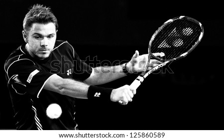 MELBOURNE - JANUARY 20: Stanislas Wawrinka of Switzerland in his marathon fourth round loss to Novak Djokovic of Serbiat the 2013 Australian Open on January 20, 2013 in Melbourne, Australia. - stock photo
