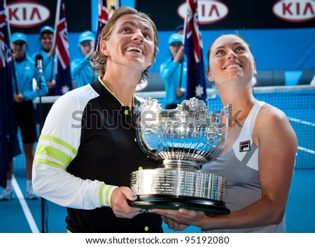 MELBOURNE - JANUARY 27: Svetlana Kuznetsova and Vera Zvonareva of Russia winning the doubles championship at the 2012 Australian Open on January 27, 2012 in Melbourne, Australia. - stock photo