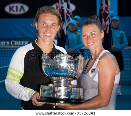 MELBOURNE - JANUARY 27: Svetlana Kuznetsova (L) and Vera Zvonareva of Russia with the doubles championship trophy at the 2012 Australian Open on January 27, 2012 in Melbourne, Australia. - stock photo