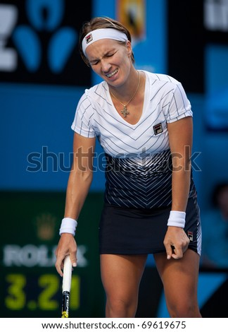 MELBOURNE - JANUARY 23: Svetlana Kuznetsova of Russia in her marathon fourth round loss to Francesca Schiavone of Italy  in the 2011 Australian Open on January 23, 2011 in Melbourne, Australia - stock photo