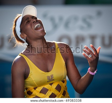 MELBOURNE - JANUARY 19: Venus Williams of the USA in her win over Sandra Zahlavova of the Czech Republic in the 2011 Australian Open - January 19, 2011 in Melbourne - stock photo