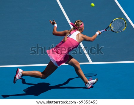MELBOURNE - JANUARY 19: Victoria Azarenka of Belarus in her win over Andrea Hlavackova of the Czech Republic in the 2011 Australian Open - January 19, 2011 in Melbourne