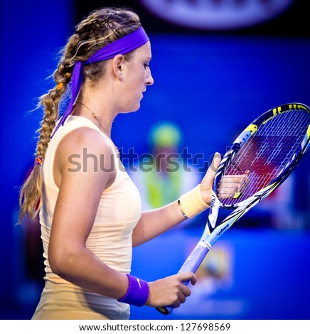MELBOURNE - JANUARY 26: Victoria Azarenka of Belarus in her win over Li Na of China in the final of the 2013 Australian Open on January 26, 2013 in Melbourne, Australia. - stock photo