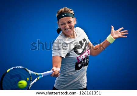 MELBOURNE - JANUARY 26:Victoria Azarenka of Belarus practices before the final at the 2013 Australian Open on January26, 2013 in Melbourne, Australia.