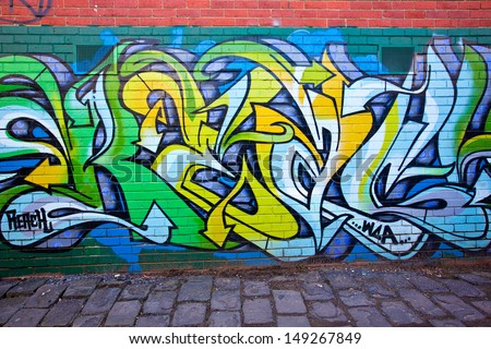 MELBOURNE - JUNE 29: Street art by unidentified artist. Melbourne's graffiti management plan recognises the importance of street art in a vibrant urban culture - June 29, 2013 in Melbourne, Australia - stock photo