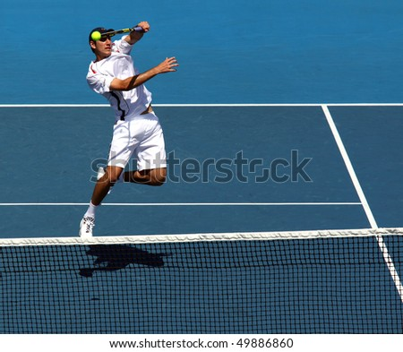 MELBOURNE - MARCH 6: Carsten Ball of Australia hits a volley in the doubles rubber of the Davis Cup tie against Chinese Taipei on March 6, 2010 in Melbourne - stock photo