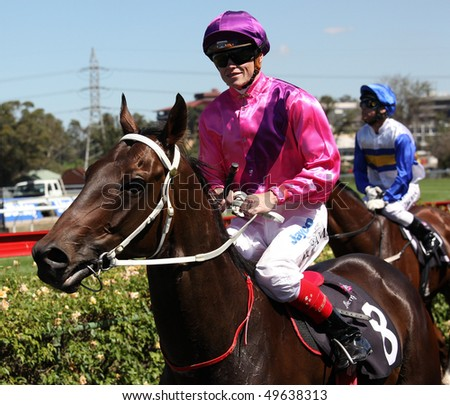 MELBOURNE - MARCH 13: Craig Williams on Boom 'n Zoom after the Roy Higgins Quality, won by Elmore at Flemington on March 13, 2010 - Melbourne, Australia. - stock photo