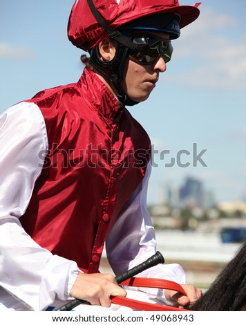 MELBOURNE - MARCH 13: Jockey Kerrin McEvoy on Denman before the start of the Crown Guineas, won by Rock Classic at Flemington on March 13, 2010 - Melbourne, Australia. - stock photo