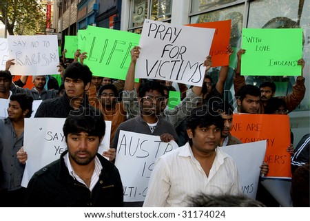 MELBOURNE - MAY 31 : Demonstrators hold placards at a rally against racism  towards Indian students May 31, 2009 in Melbourne, Australia.
