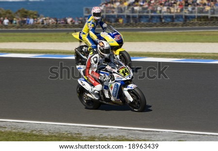 MELBOURNE - OCTOBER 4: Randy de Puniet and Colin Edwards at the MotoGP race on October 4, 2008 on Phillip Island, Melbourne Australia. - stock photo