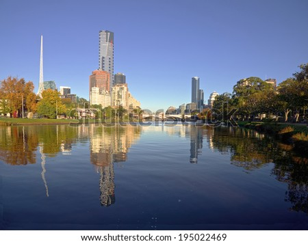 melbourne on a sunny autumn day with yarra river in foreground - stock photo