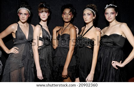 "MELBOURNE - SEPTEMBER 25: A group of female models wearing garments by Anna Campbell, backstage at ""Seven"" nightclub on September 25, 2008 in Melbourne. - stock photo"