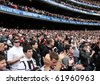 MELBOURNE - SEPTEMBER 25: Crowd at the Collingwood vs St Kilda drawn AFL Grand Final at the MCG - September 25, 2010 in Melbourne, Australia. - stock photo
