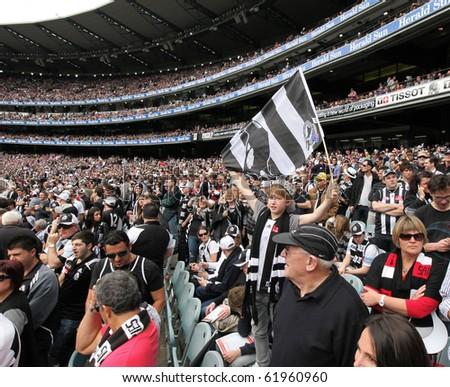MELBOURNE - SEPTEMBER 25: Crowd at the Collingwood vs St Kilda drawn AFL Grand Final at the MCG - September 25, 2010 in Melbourne, Australia. - stock photo